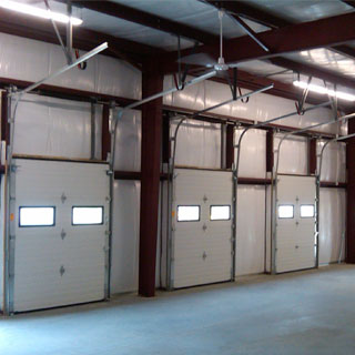 Metal building loading dock garage doors